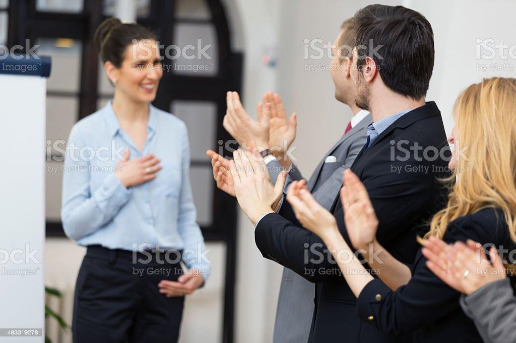 Applauding fsuccessful presentationor stock photo