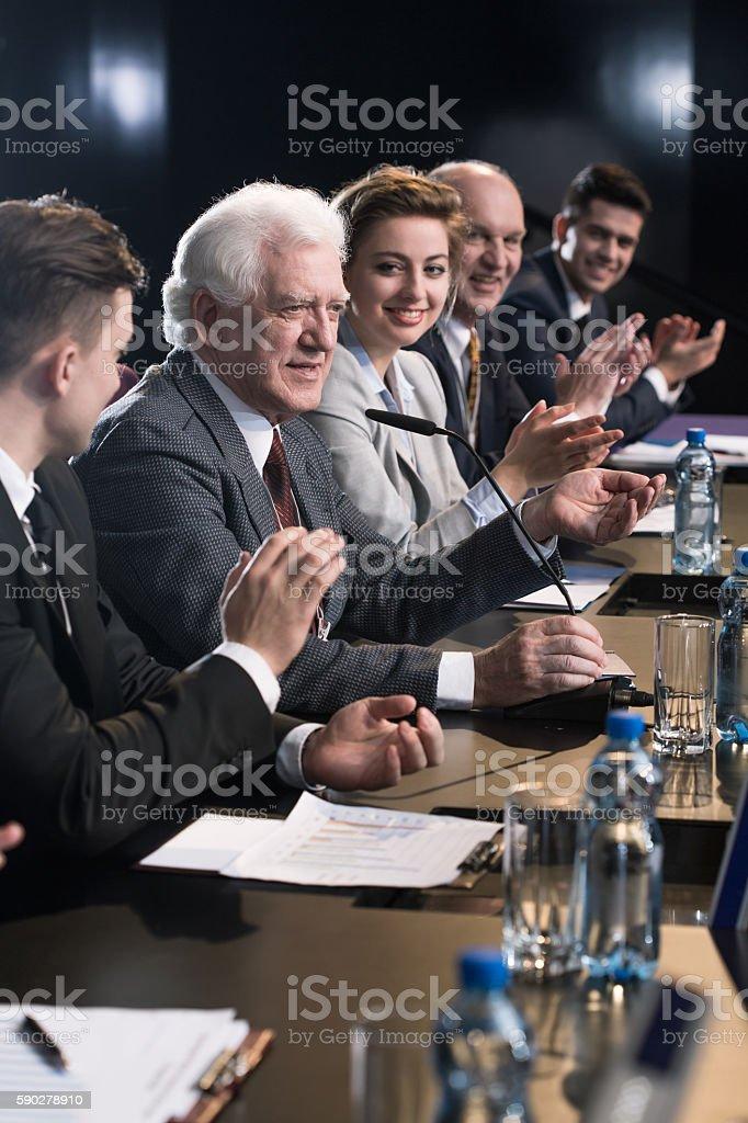 Applauding mature businessman stock photo