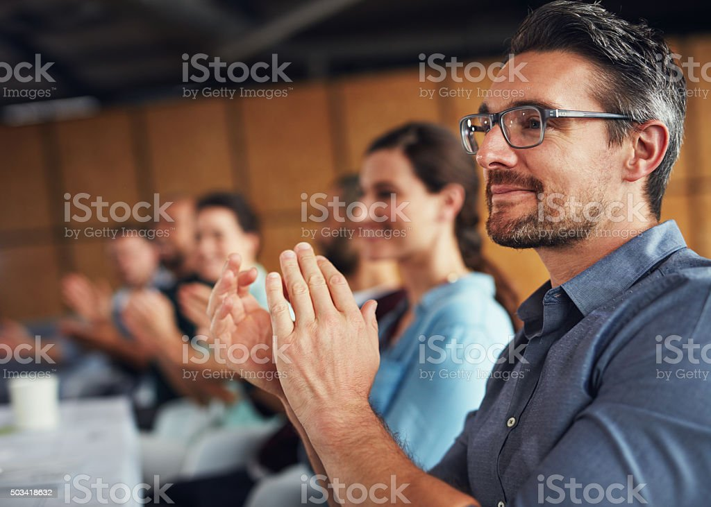 Applauding their achievements stock photo