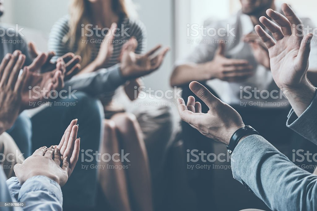 Applauding their success. stock photo