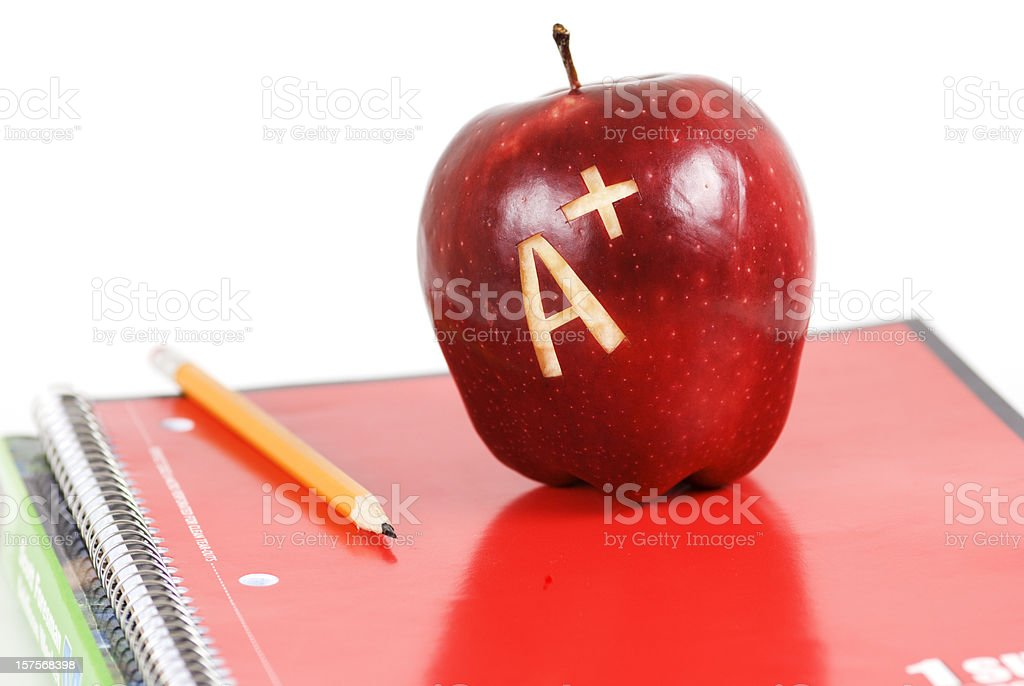 Apple A+ and books royalty-free stock photo