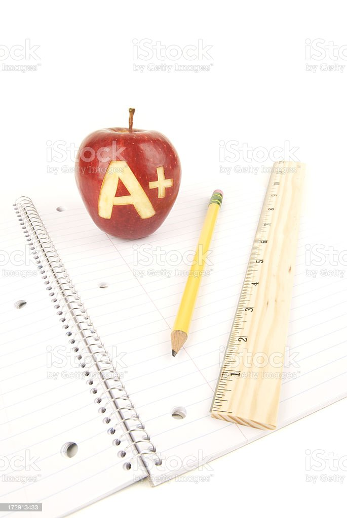 Apple A+ Pencil Ruler Notebook royalty-free stock photo