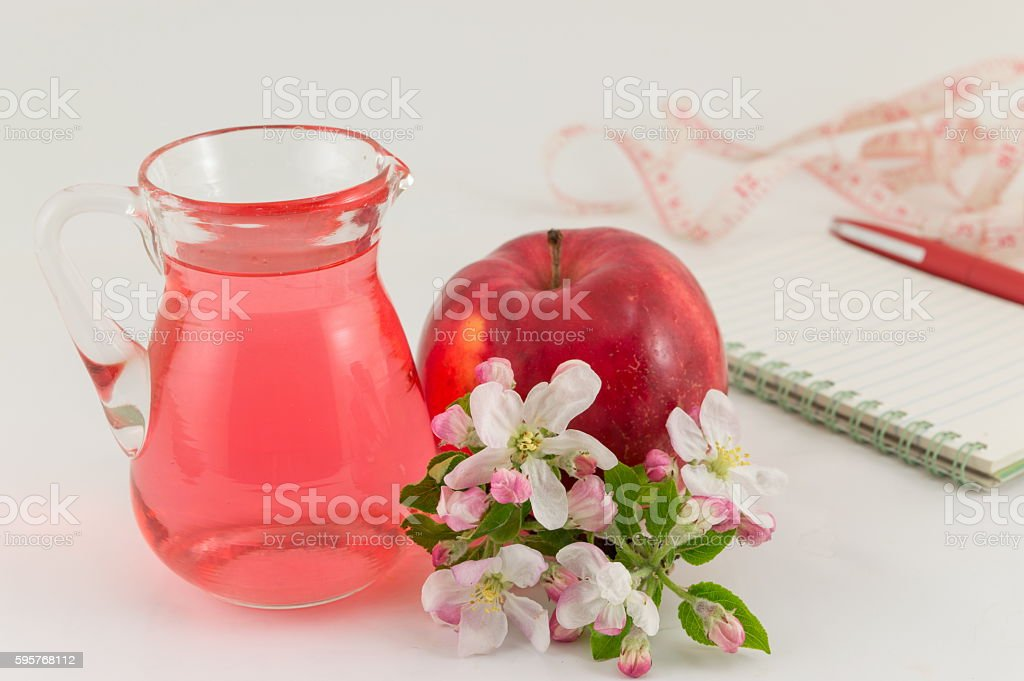 Apple and apple vinegar decorated with flowers stock photo