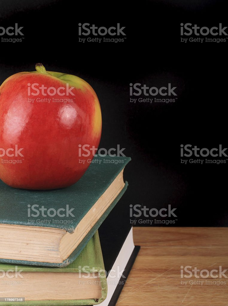 Apple and books for back to school royalty-free stock photo
