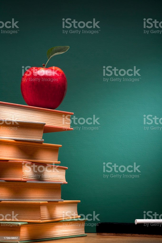 Apple and Books in School room royalty-free stock photo