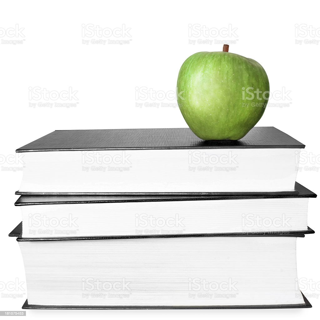 Apple and books on a white background royalty-free stock photo