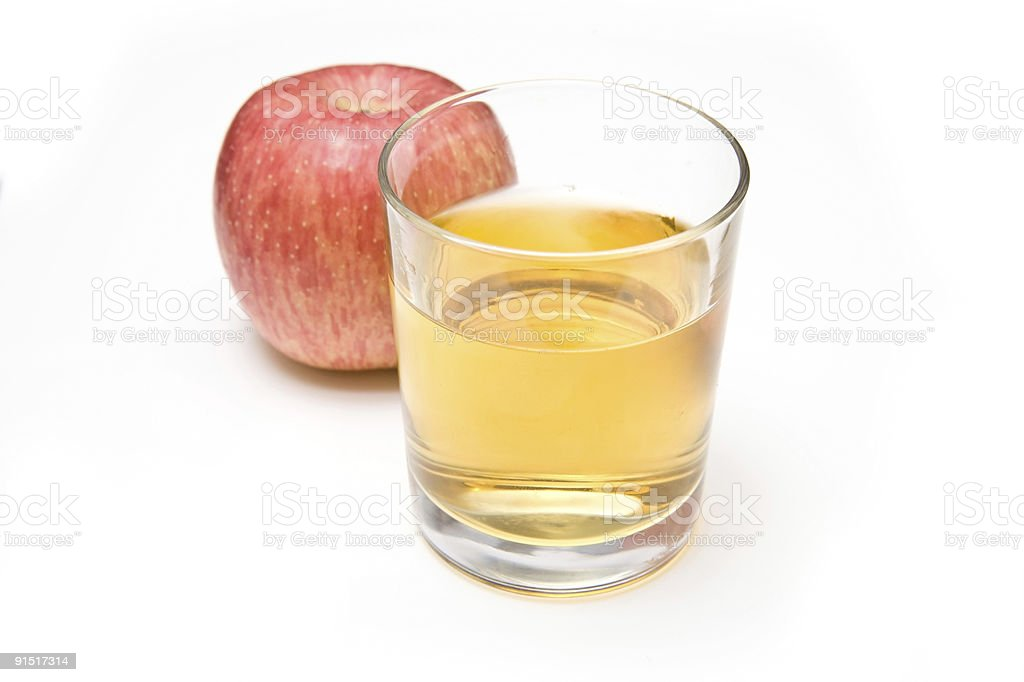 Apple and juice on a white background stock photo