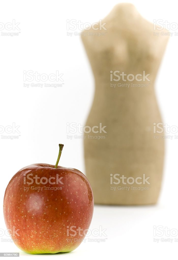 Apple and mannequin royalty-free stock photo