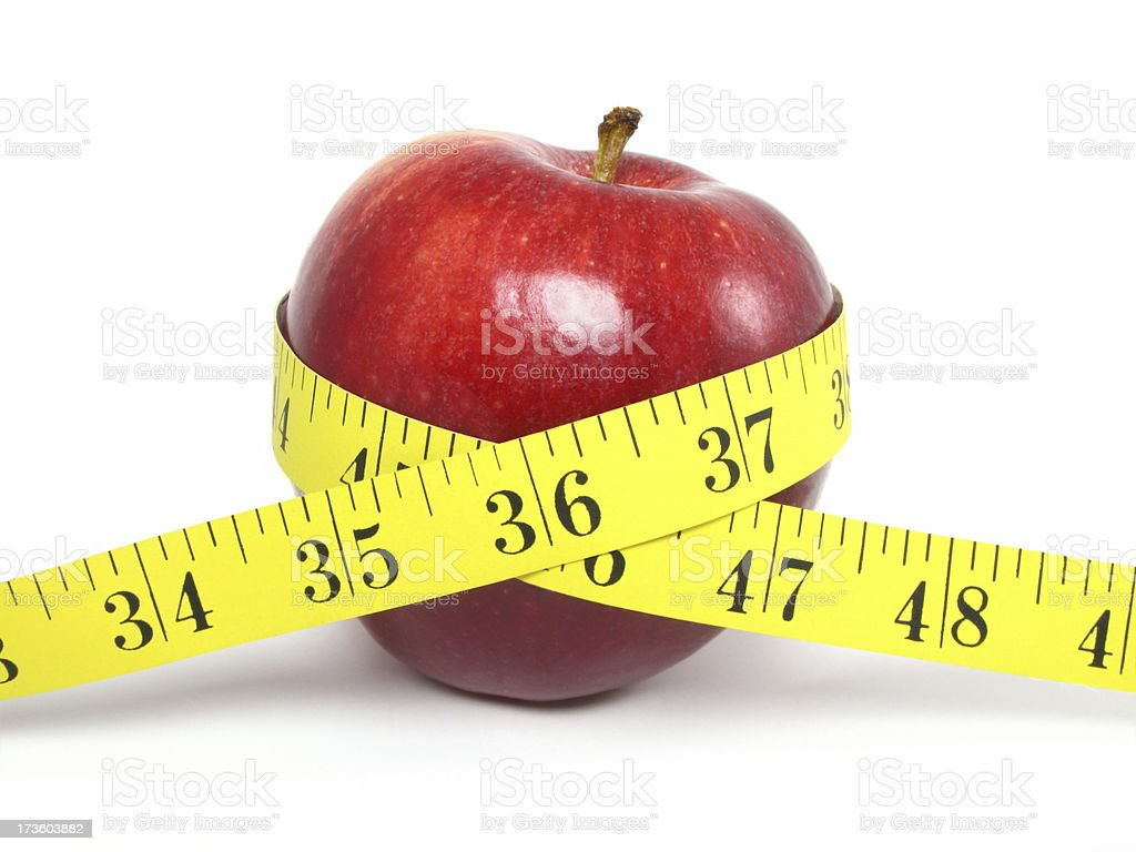 Apple and Measure Tape royalty-free stock photo