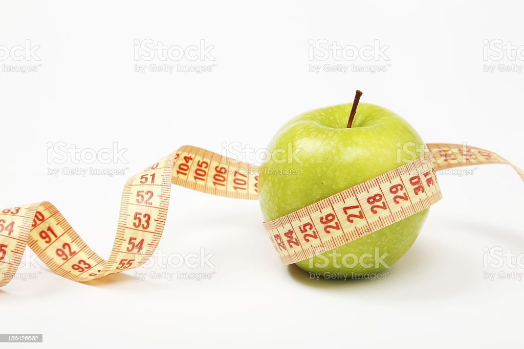 Apple and measurement tape royalty-free stock photo