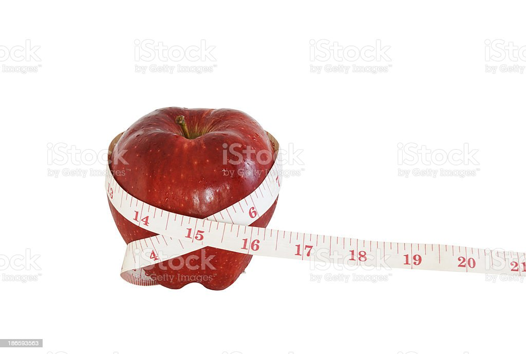 Apple and measuring tape on white background royalty-free stock photo