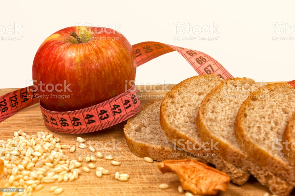 Apple and measuring tape, wheat stock photo