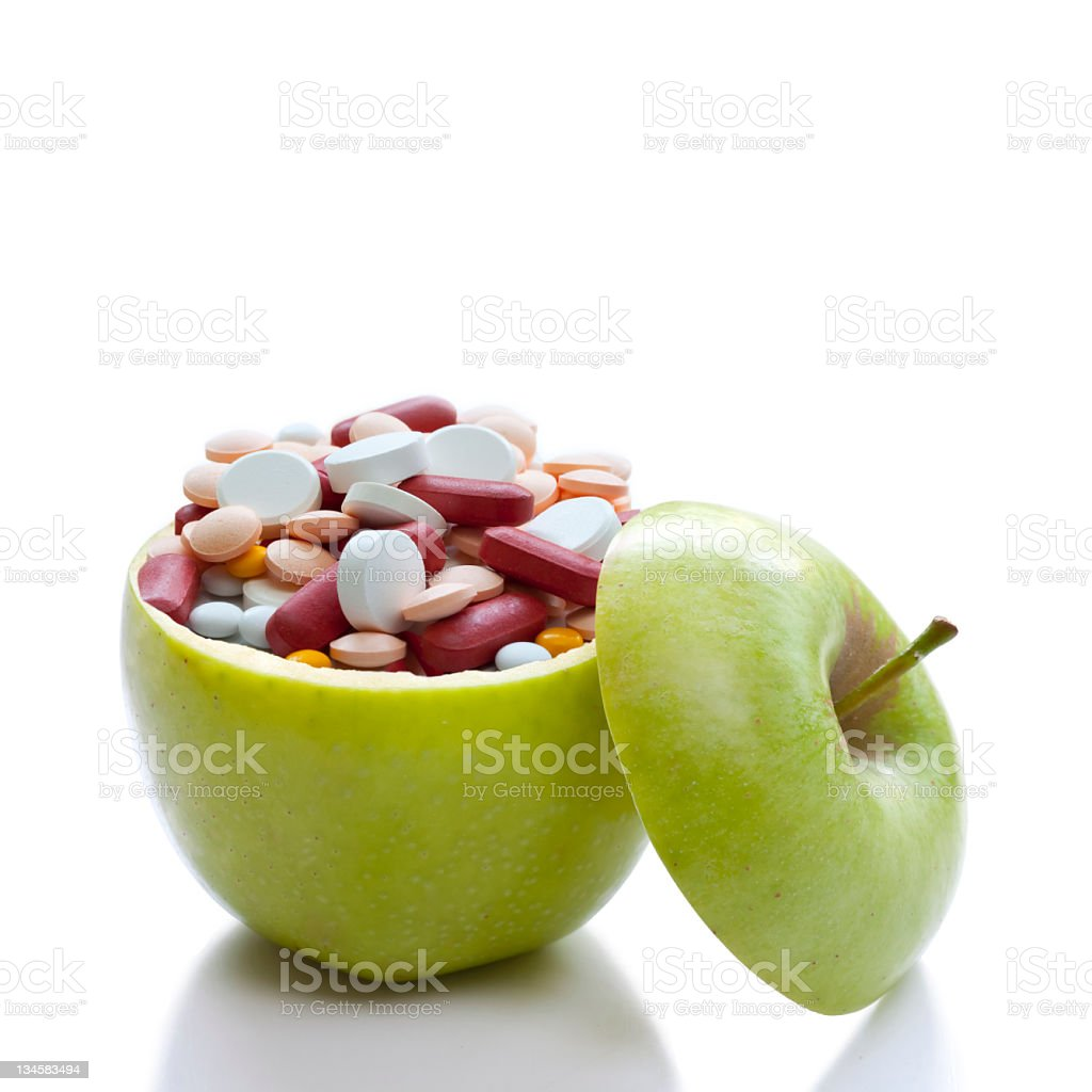 Apple and medicine royalty-free stock photo