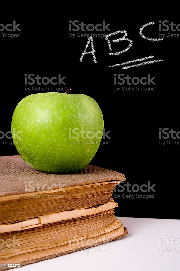 Apple and old dictionary royalty-free stock photo