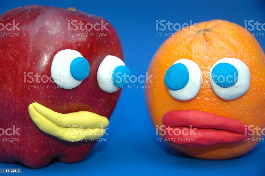 Apple and Orange Comparison royalty-free stock photo