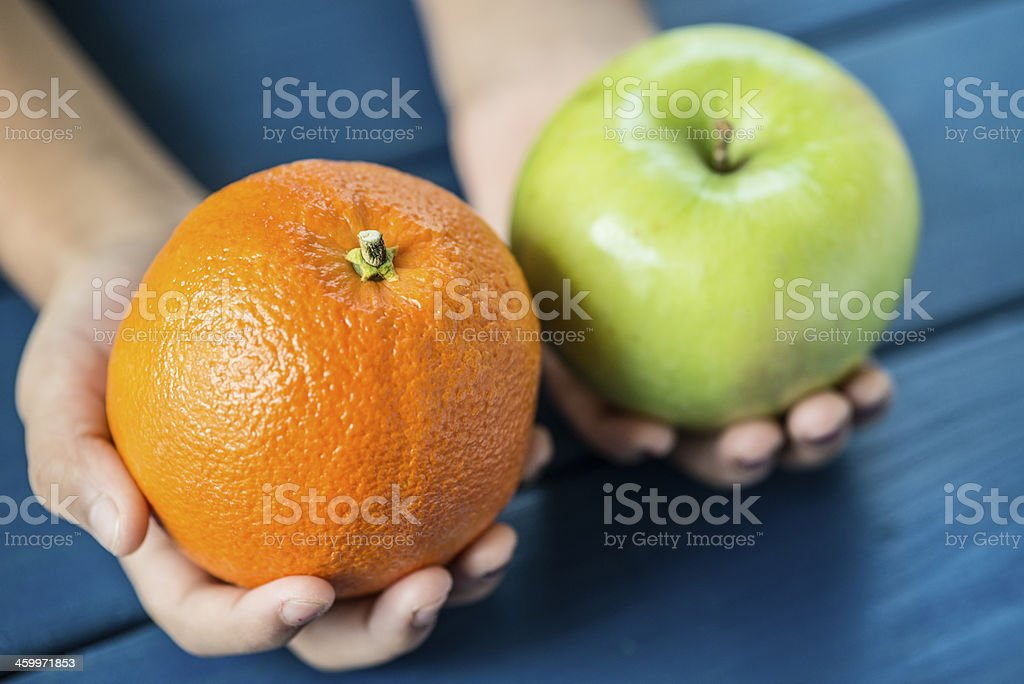 Apple and orange comparison stock photo