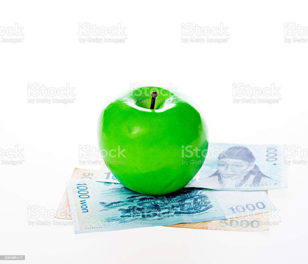 Apple and South Korea currency stock photo