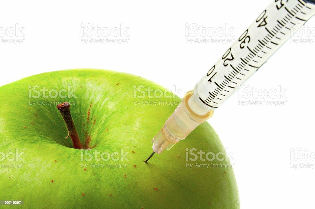 apple and syringe royalty-free stock photo