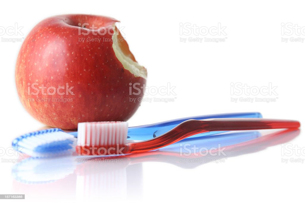 Apple and toothbrushes stock photo