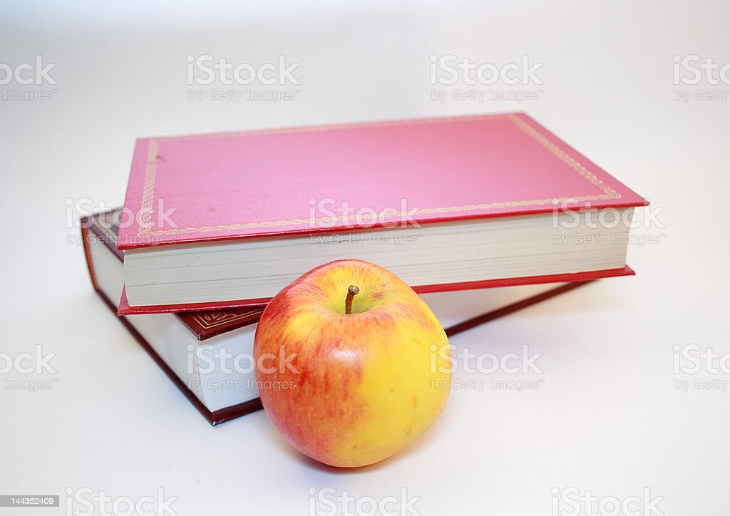 apple and two books royalty-free stock photo