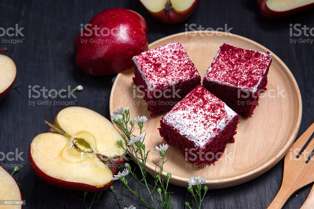 Apple cake in the wood dish lay on black wood table stock photo