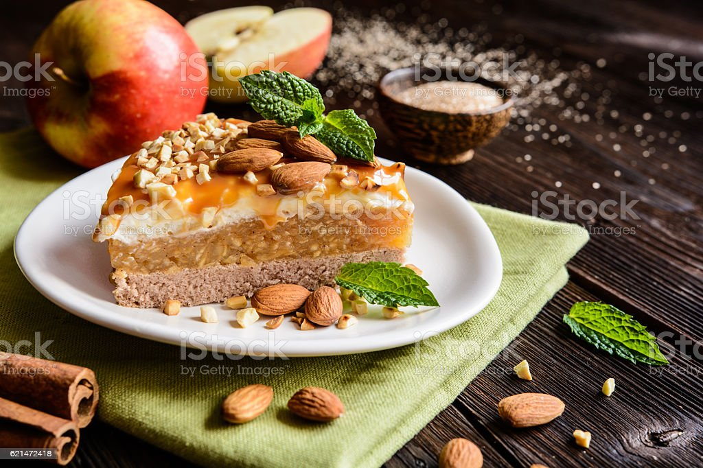 Apple cake with whipped cream, caramel and almond topping stock photo