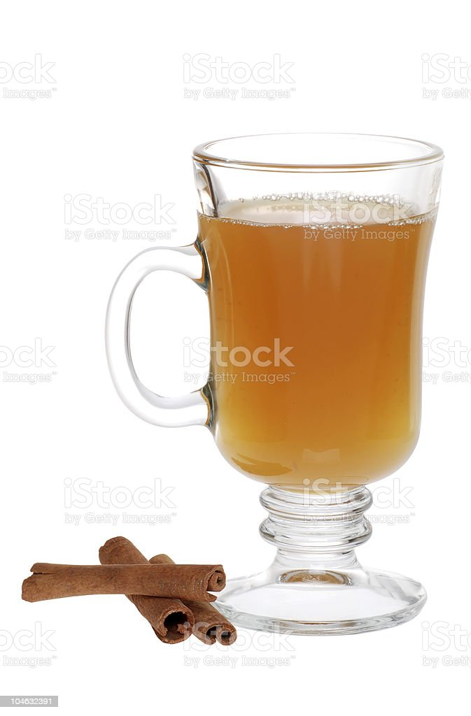 apple cider and cinnamon sticks stock photo
