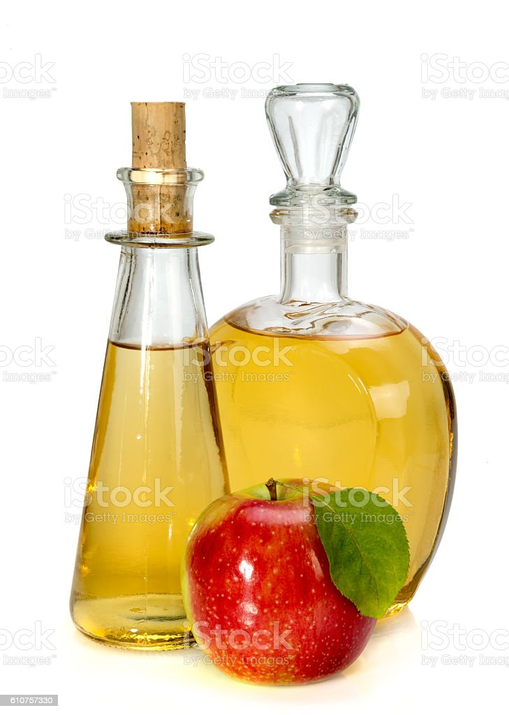apple cider vinegar in a glass vessel and red apple stock photo