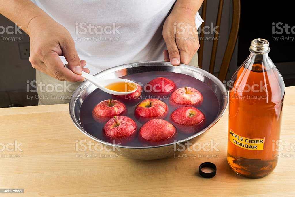 Apple Cider Vinegar to soak fruits and remove pesticide residue stock photo