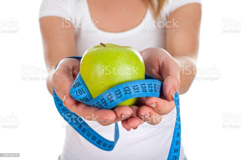 Apple diet & measuring tape stock photo