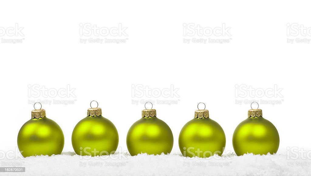 Apple Green Baubles in Snow royalty-free stock photo