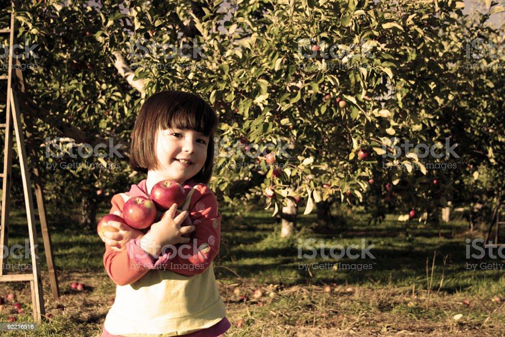 Apple hugging royalty-free stock photo
