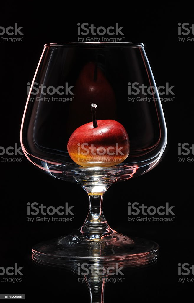Apple in a wine glass royalty-free stock photo