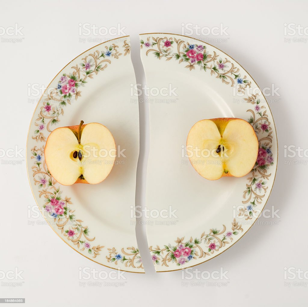 Apple in broken dish stock photo