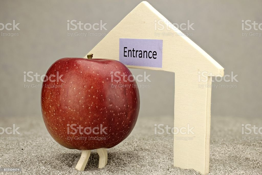 Apple in front of entrance stock photo