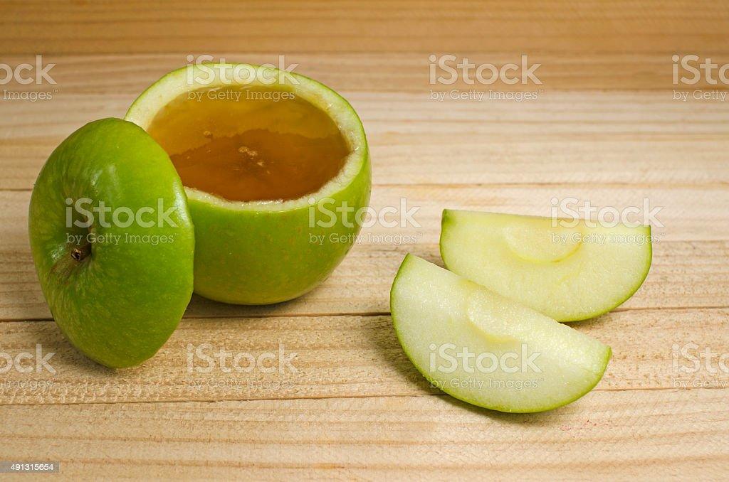 Apple in honey for Rosh Hashanah stock photo