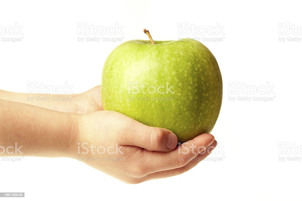 Apple in the hands stock photo