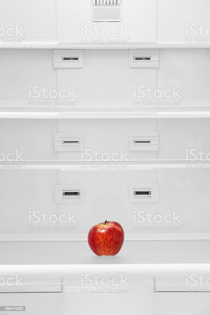 Apple in the refrigerator stock photo