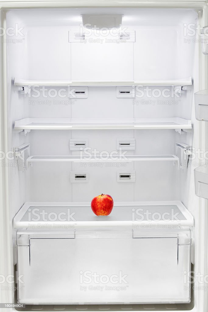 Apple in the refrigerator royalty-free stock photo