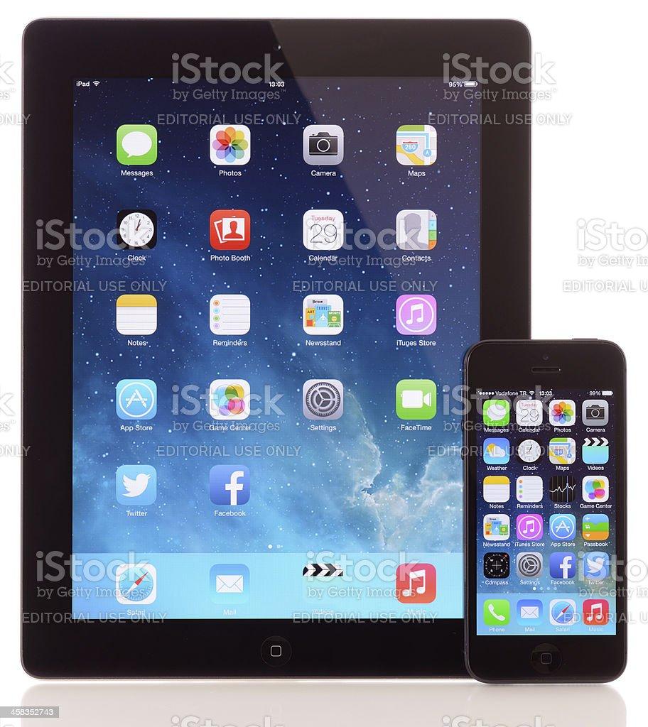 Apple iOS 7 home screen on iPad & iPhone 5 royalty-free stock photo