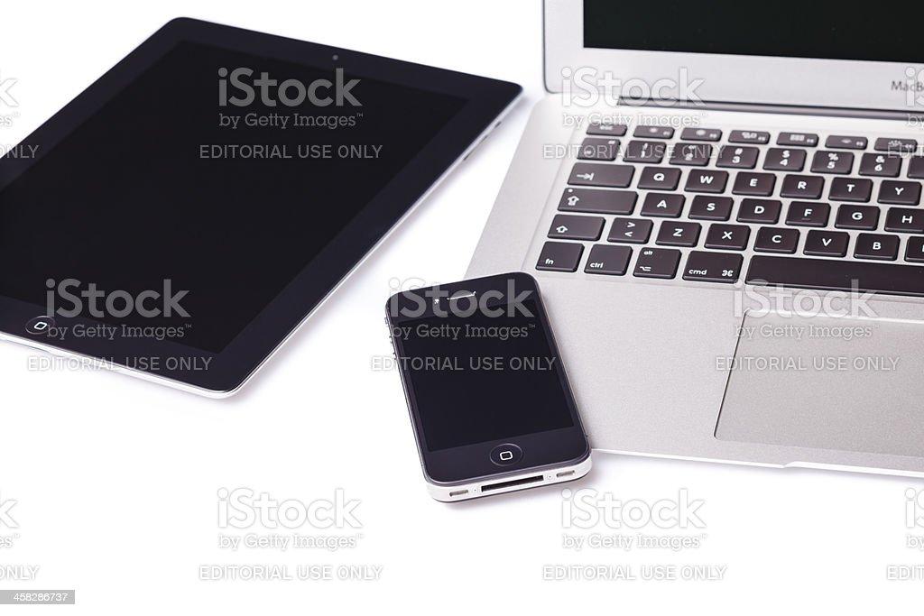 Apple iPad 2, iPhone 4 and 13' MacBook Air royalty-free stock photo
