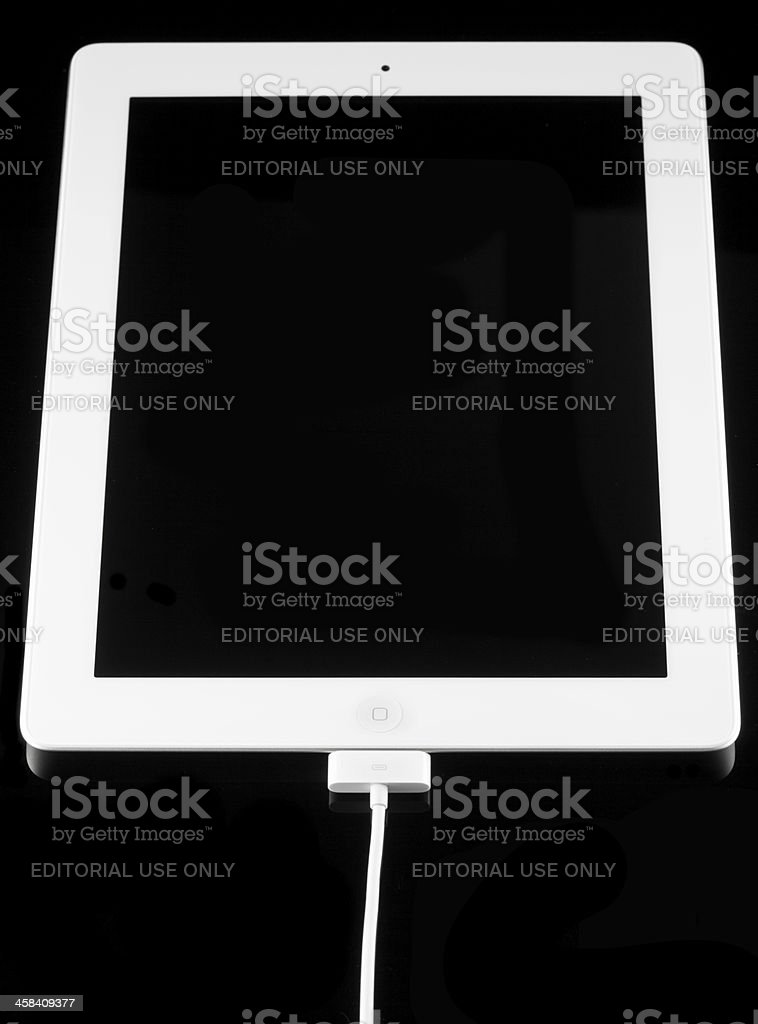 Apple iPad 2 with Battery Charger royalty-free stock photo