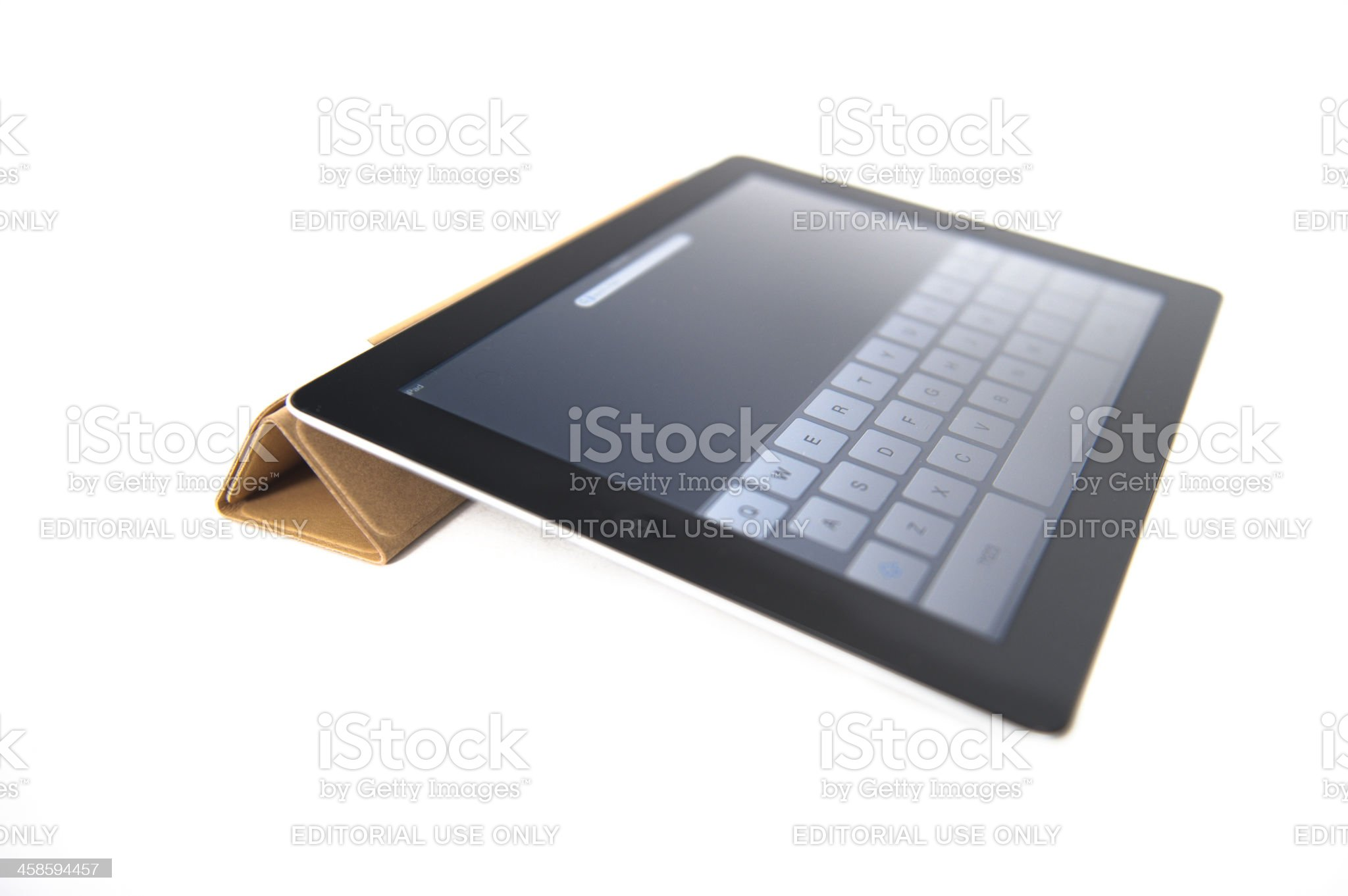 Apple Ipad 2 with Brown Leather Smart Cover royalty-free stock photo
