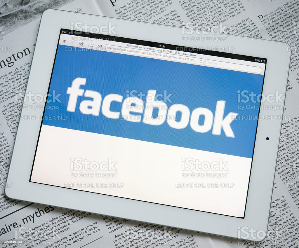 Apple Ipad 2 with Facebook.com web site on screen stock photo