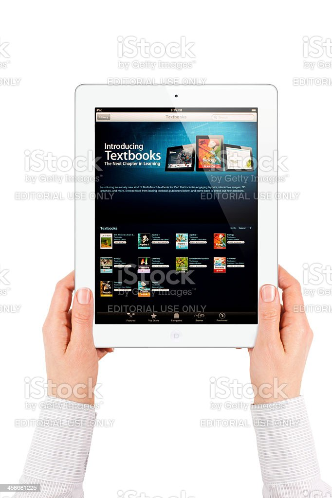 Apple iPad 2 with Textbook royalty-free stock photo