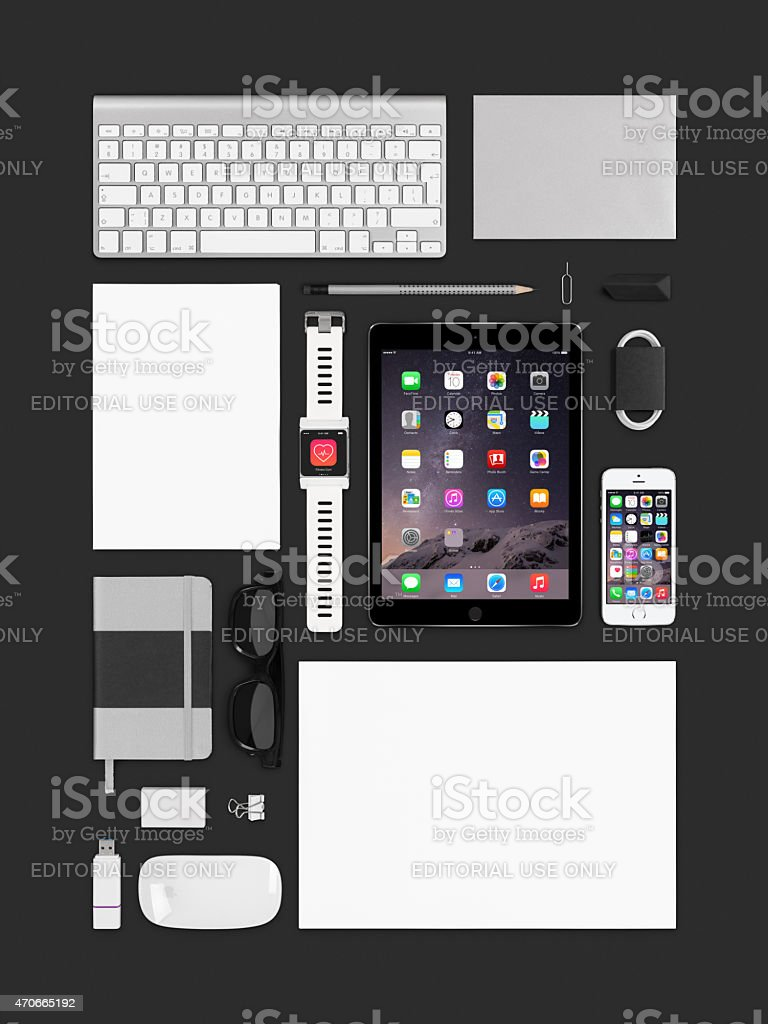 Apple ipad air 2, iphone 5s, keyboard, mouse and smartwatch stock photo