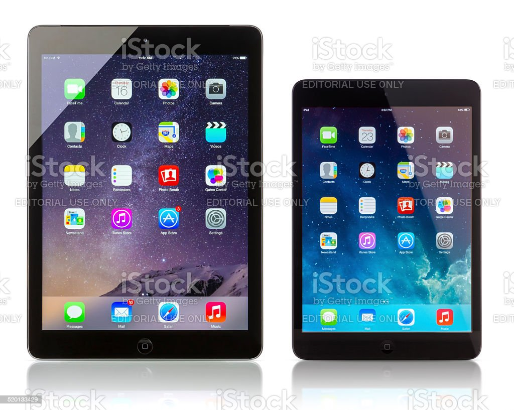 Apple iPad Air and iPad Mini displaying homescreen stock photo