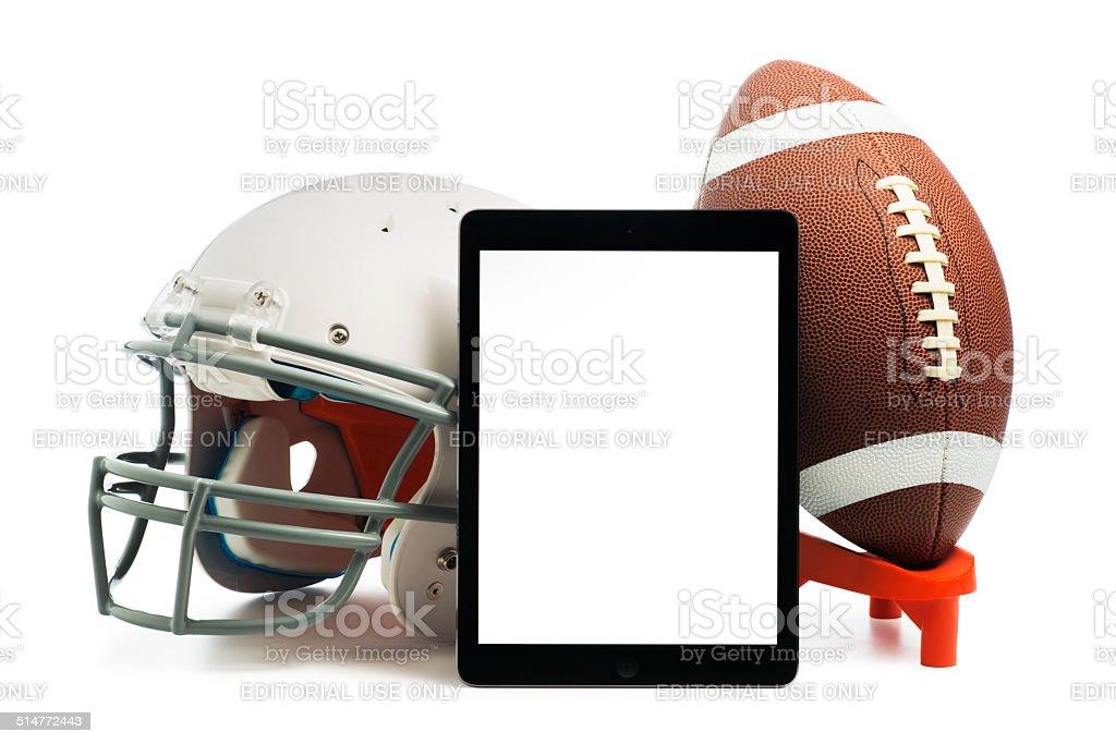 Apple iPad air with a Football and helmet stock photo