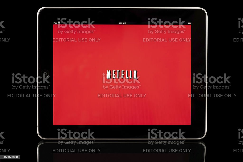 Apple iPad displaying Netflix app, Black with Reflection stock photo