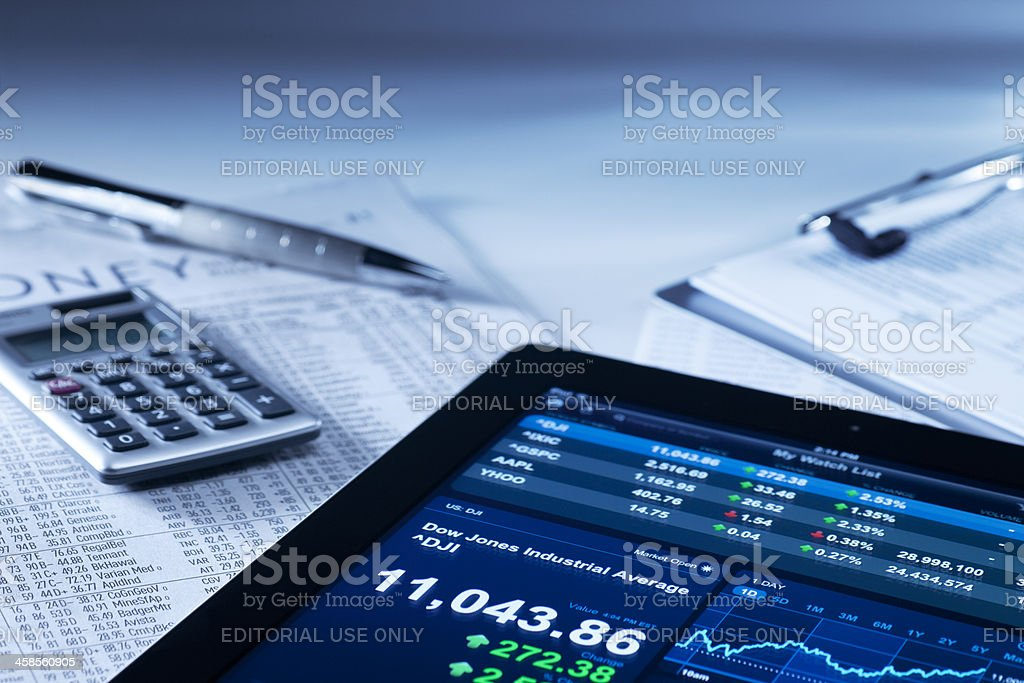 Apple iPad II in a Business and Finance Setting royalty-free stock photo
